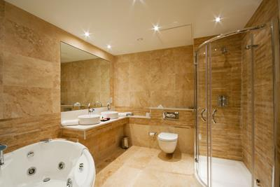 Modern Bathroom interior with marble tiles and mirror
