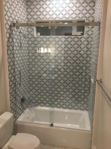 frameless shower on a guest bath with beautiful tile work