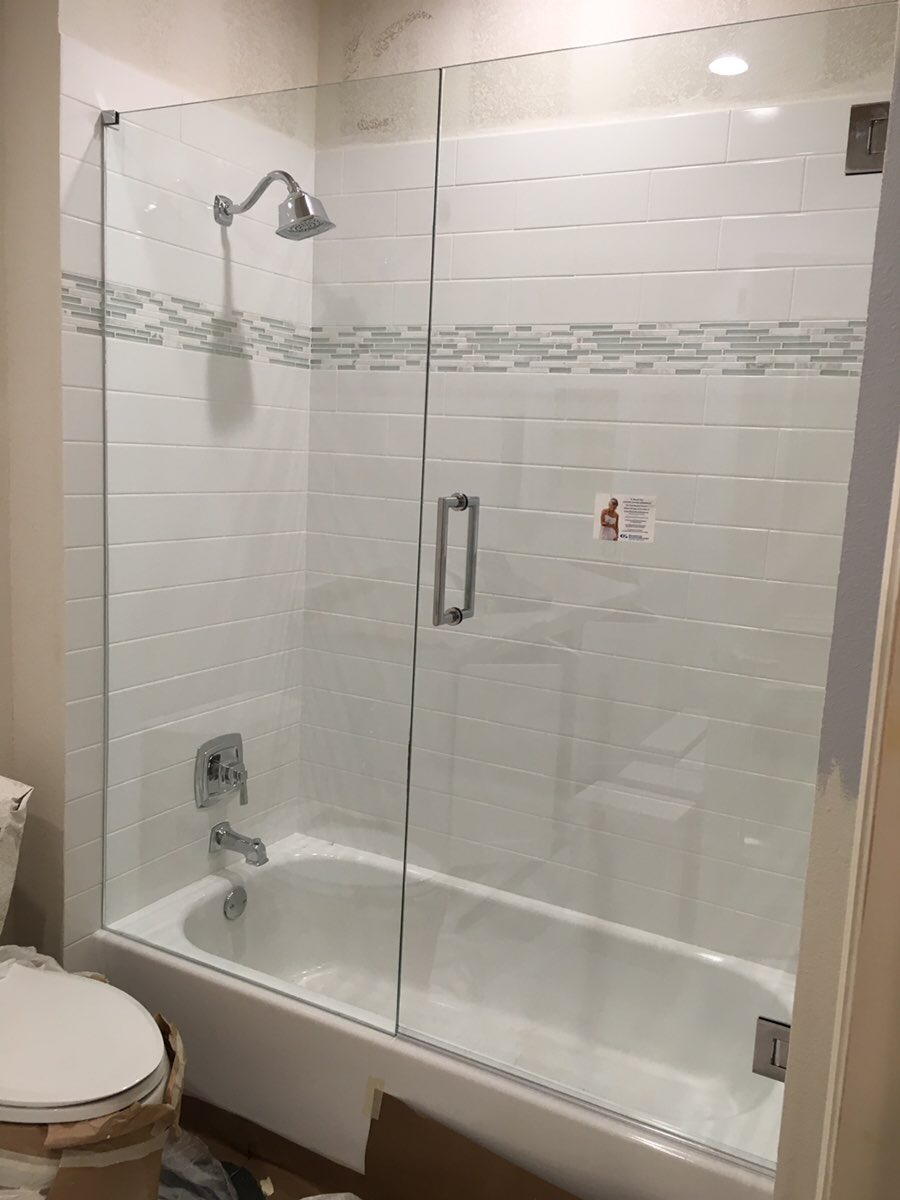 Frameless Shower Door and panel on tub