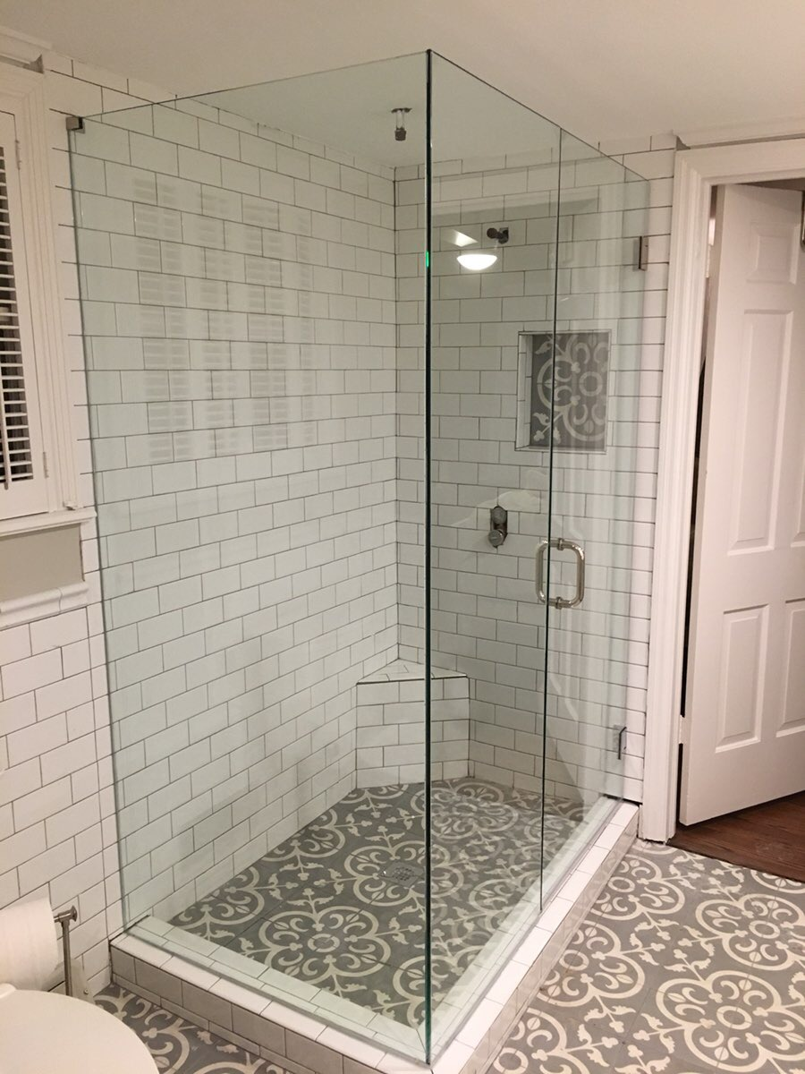 Frameless seamless custom shower enclosure