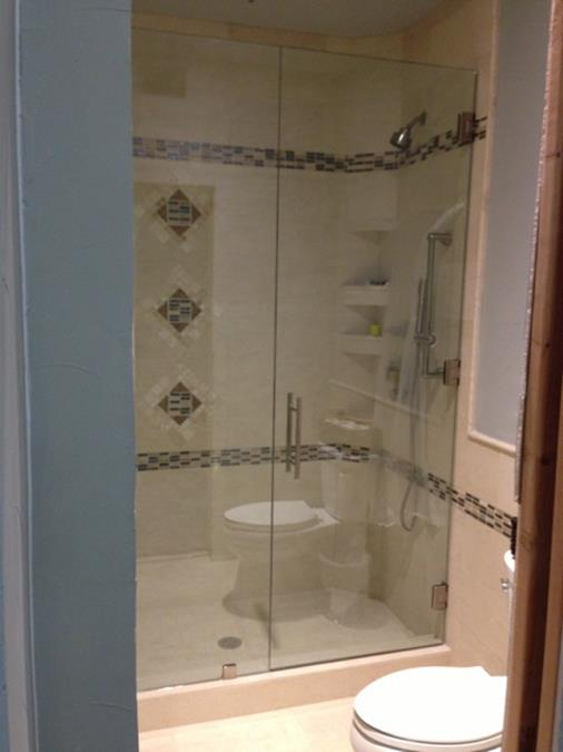 Frameless seemless door with inline panel shower enclosure (Copy)