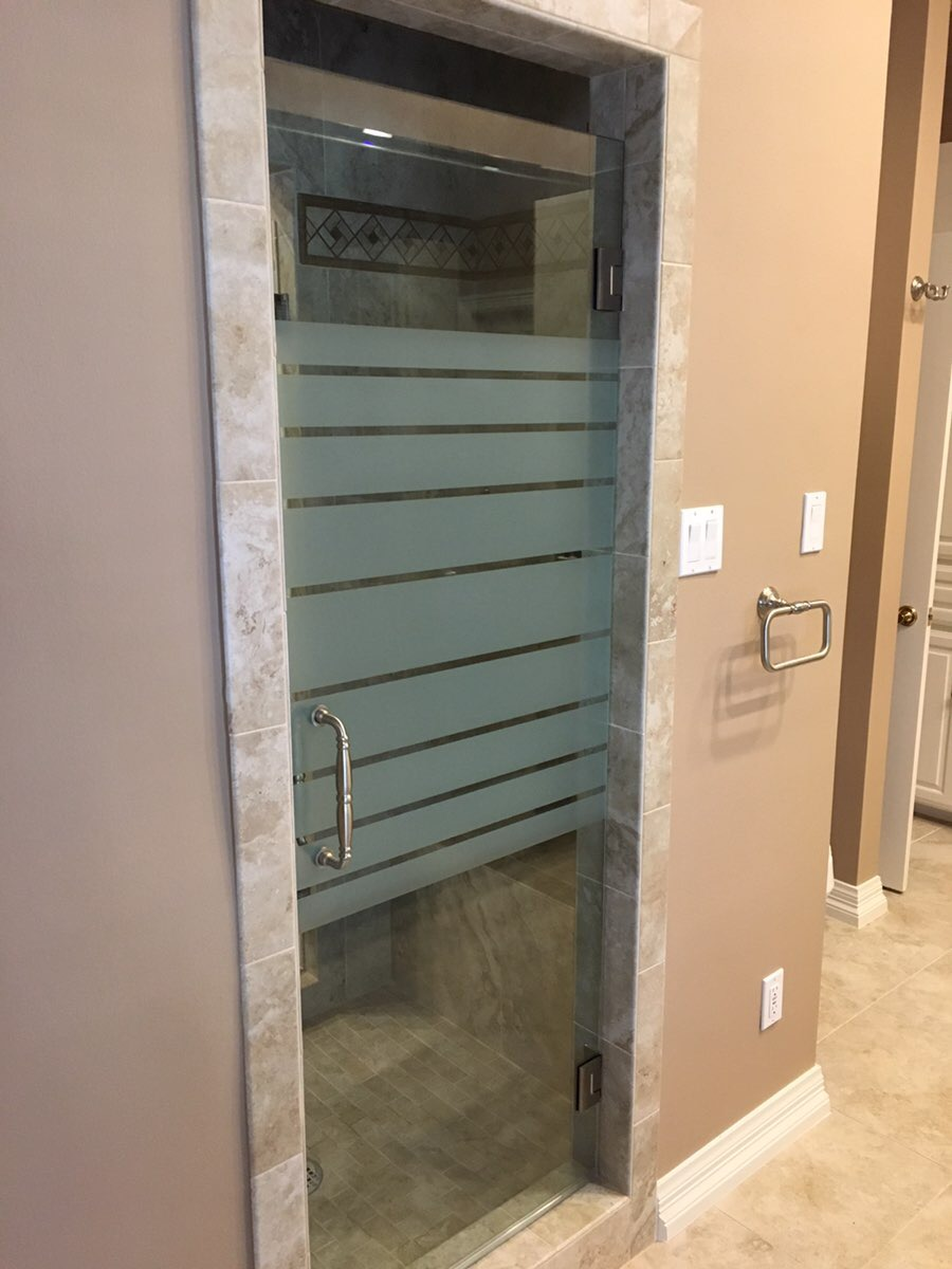 Frameless shower door with frosted privacy stripes
