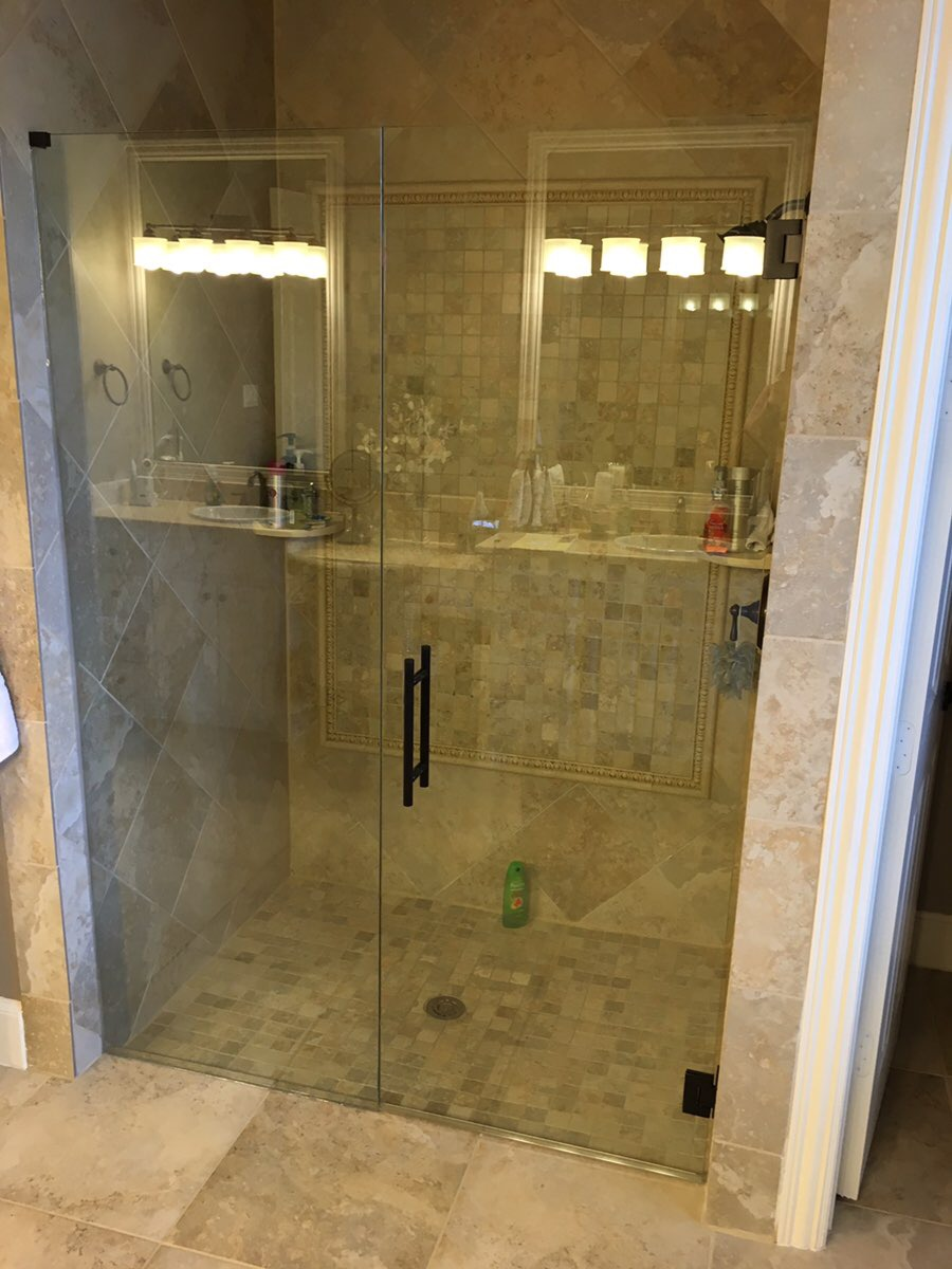 Frameless shower door with inline panel removed tub