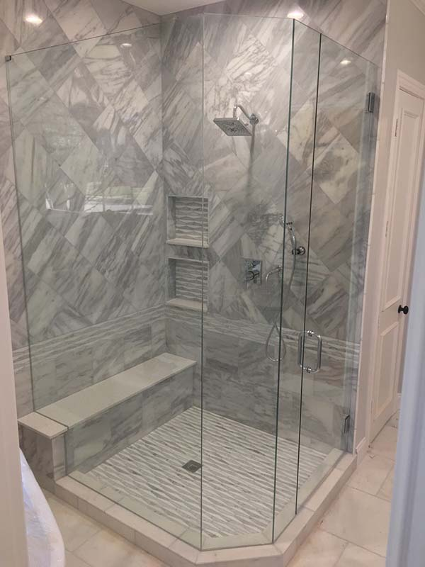 Frameless shower enclosure with mitered corners full height seamless
