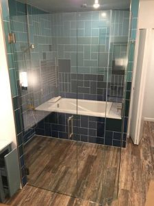 frameless tub and shower enclosure
