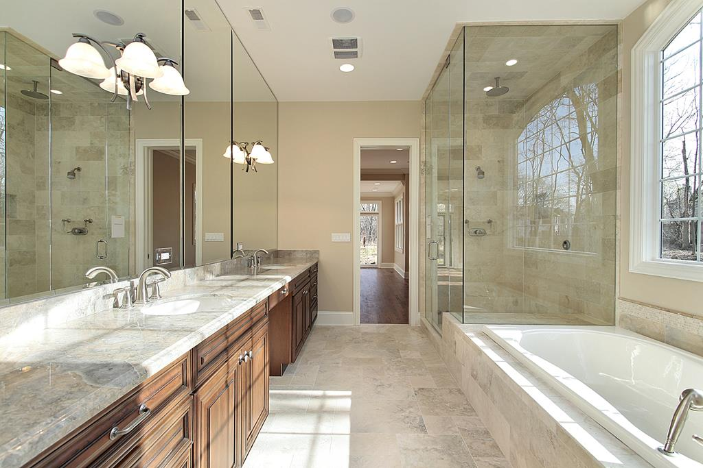 master bath with dramatic shower enclosure to ceiling